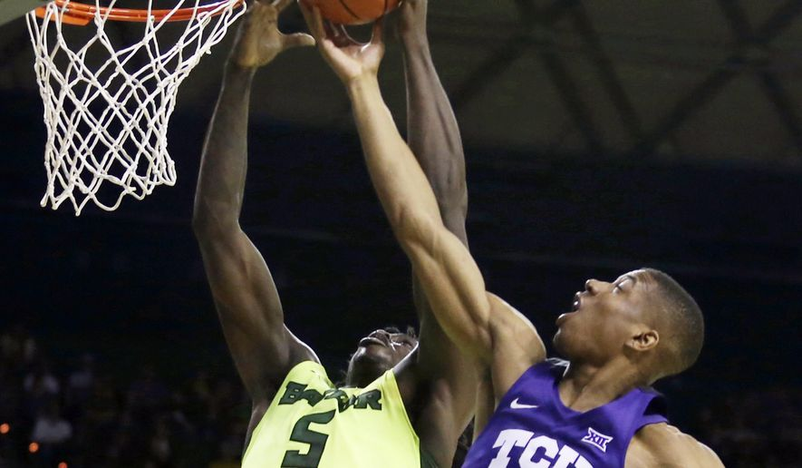 Baylor forward Johnathan Motley (5) rebounds the ball against TCU guard Brandon Parrish (11) in the first half of an NCAA college basketball game, Saturday, Feb. 11, 2017, in Waco, Texas. (AP Photo/Jerry Larson)