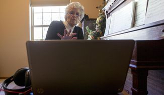 ADVANCE FOR THE WEEKEND OF FEB 11-12 AND THEREAFTER - In a Jan. 13, 2017 photo, Diann Murdock sets up her laptop before a recording session in her apartment at Primrose Retirement Community in Gillette, Wyo. Murdock has been working to record herself playing the piano at home, in hopes of leaving behind a body of music for her family.  (Steel Brooks/Gillette News Record via AP)