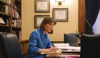 Minnesota Attorney General Lori Swanson reviews evidence in the case of President Donald Trump's immigration ban targeting seven predominantly Muslim countries in her office at the State Capitol building in St. Paul, Minn., on Friday, Feb. 10, 2017. (Anthony Souffle/Star Tribune via AP)