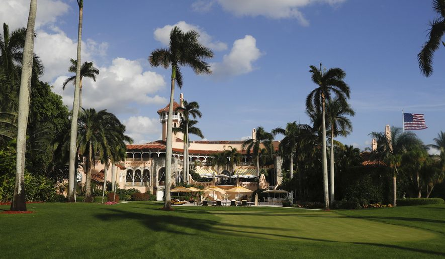 FILE - In this Nov. 27, 2016 file photo, Mar-a-Lago is seen from the media van window in Palm Beach, Fla. Trump has described the sprawling Mar-a-Lago property as the Winter White House and has spent two weekends there this month.   (AP Photo/Carolyn Kaster, File)