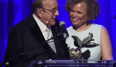 Clive Davis, left, honors Debra L. Lee, BET Network chairman/CEO, as the GRAMMY Salute To Industry Icon at the Clive Davis and The Recording Academy Pre-Grammy Gala at the Beverly Hilton Hotel on Saturday, Feb. 11, 2017, in Beverly Hills, Calif. (Photo by Chris Pizzello/Invision/AP)