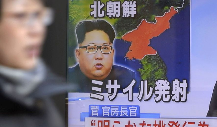 An image of North Korean leader Kim Jong-un appears in a TV news report about the country's missile launch Sunday, an early test of the Trump administration. (Associated Press)