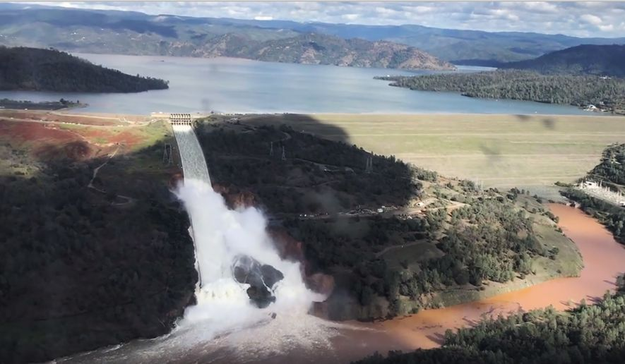 This Friday, Feb. 10, 2017 image from video provided by the office of Assemblyman Brian Dahle shows water flowing over an emergency spillway of the Oroville Dam in Oroville, Calif., during a helicopter tour by the Butte County Sheriff's office. About 150 miles northeast of San Francisco, Lake Oroville is one of California's largest man-made lakes, and the 770-foot-tall Oroville Dam is the nation's tallest. (Josh F.W. Cook/Office of Assemblyman Brian Dahle via AP)