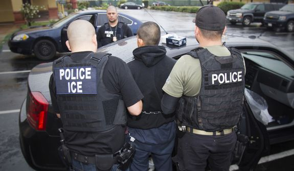 In this Tuesday, Feb. 7, 2017, photo released by U.S. Immigration and Customs Enforcement, foreign nationals are arrested during a targeted enforcement operation conducted by U.S. Immigration and Customs Enforcement (ICE) aimed at immigration fugitives, re-entrants and at-large criminal aliens in Los Angeles. Advocacy groups said that Immigration and Customs Enforcement officers are rounding up people in large numbers around the country, with roundups in Southern California being especially heavy-handed, as part of stepped-up enforcement under President Donald Trump. (Charles Reed/U.S. Immigration and Customs Enforcement via AP)