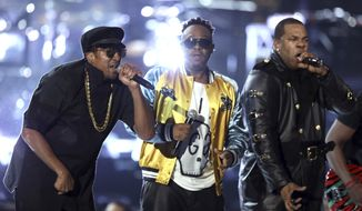 Q-Tip, from left, Phife Dawg, and Jarobi White, from A Tribe Called Quest, perform at the 59th annual Grammy Awards on Sunday, Feb. 12, 2017, in Los Angeles. (Photo by Matt Sayles/Invision/AP)