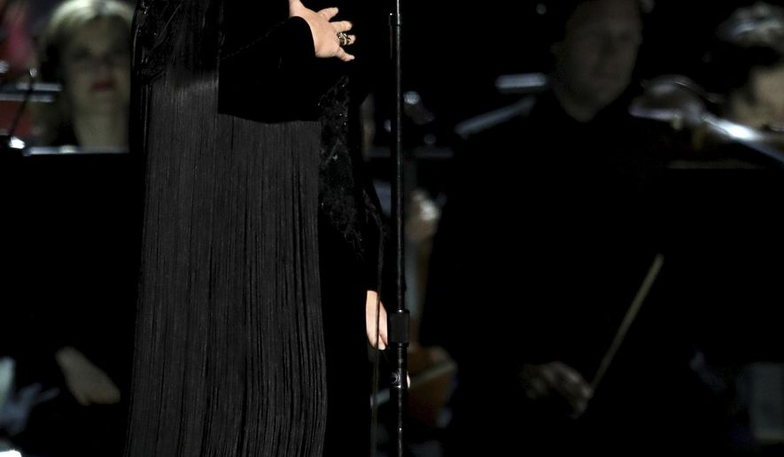 Adele apologizes before restarting a performance tribute to George Michael at the 59th annual Grammy Awards on Sunday, Feb. 12, 2017, in Los Angeles. (Photo by Matt Sayles/Invision/AP)