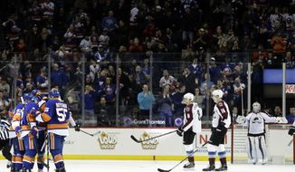 The New York Islanders celebrate a goal by Nick Leddy as Colorado Avalanche goalie Calvin Pickard, right, reacts during the first period of an NHL hockey game Sunday, Feb. 12, 2017, in New York. (AP Photo/Frank Franklin II)