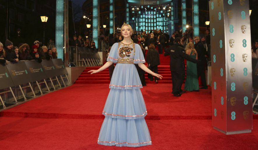 Actress Anya Taylor-Joy poses for photographers upon arrival at the British Academy Film Awards in London, Sunday, Feb. 12, 2017. (Photo by Joel Ryan/Invision/AP)