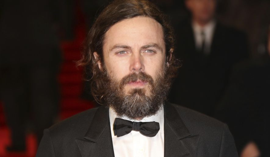 Actor Casey Affleck poses for photographers upon arrival at the British Academy Film Awards in London, Sunday, Feb. 12, 2017. (Photo by Joel Ryan/Invision/AP)