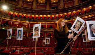 BAFTA staff lay out heads-on-sticks marking the seating plan at the Royal Albert Hall in London, Thursday, Feb. 9, 2017, ahead of the EE British Academy Film Awards on Sunday Feb. 12. (Photo by Joel Ryan/Invision/AP)
