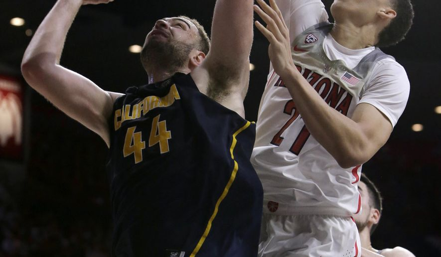 California center Kameron Rooks (44) shoots in front of Arizona center Chance Comanche during the first half of an NCAA college basketball game, Saturday, Feb. 11, 2017, in Tucson, Ariz. (AP Photo/Rick Scuteri)