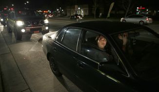 Kendra Curieo waits in traffic to evacuate Marysville, Calif., Sunday, Feb. 12, 2017. Thousands of residents of Marysville and other Northern California communities were told to leave their homes Sunday evening as an emergency spillway of the Oroville Dam could fail at any time unleashing flood waters from Lake Oroville, according to officials from the California Department of Water Resources. (AP Photo/Rich Pedroncelli)