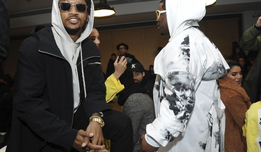 Rapper Trey Songz, left, attends the Public School runway show during Fashion Week in New York, Sunday, Feb. 12, 2017. (AP Photo/Diane Bondareff)
