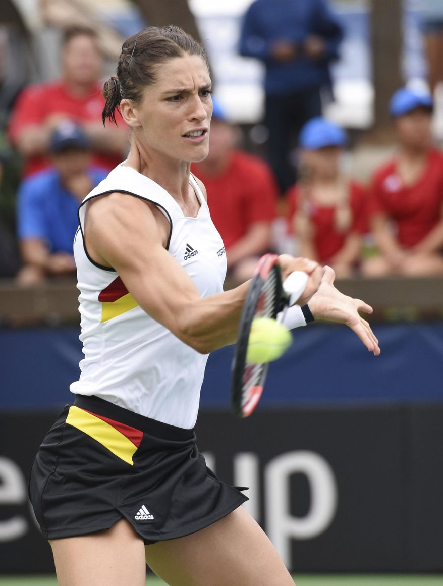 Germany's Andrea Petkovic hits to Uniuted States' Alison Riske in a Fed Cup tennis quarterfinal in Lahaina, Hawaii, Saturday, Feb. 11, 2017. (Matthew Thayer/The Maui News via AP)