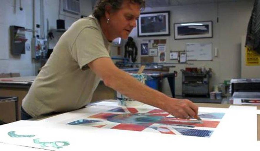 Rick Allen at work in his art studio.