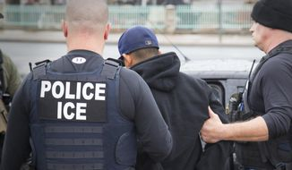 President Trump has created a determined focus at the Homeland Security and State departments, which are both involved in speeding up deportations. (Associated Press/File)