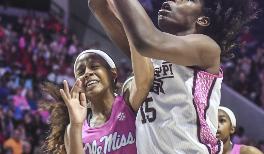 Mississippi guard Madinah Muhammad (20) fouls Mississippi State center Teaira McCowan (15) during an NCAA college basketball game in Oxford, Miss., Sunday, Feb. 12, 2017. (Bruce Newman/Oxford Eagle via AP)