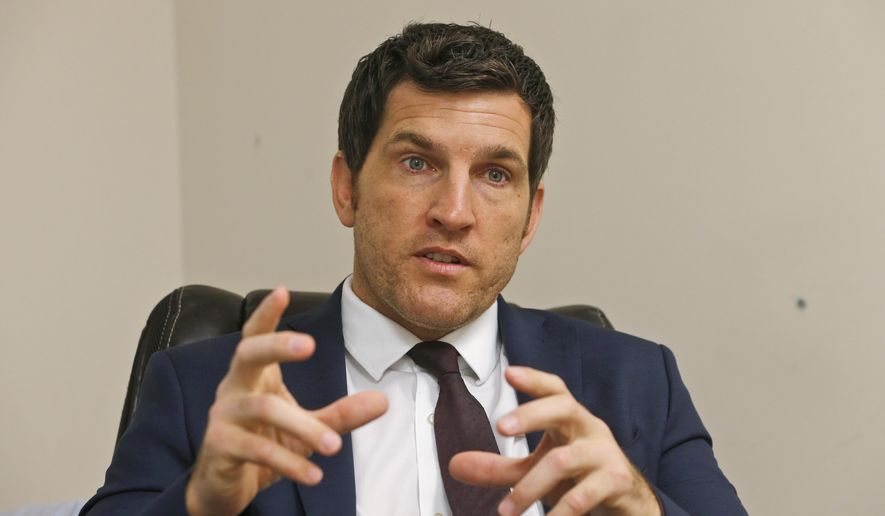 In this Friday, Oct. 7, 2016, file photo, Virginia's 2nd District Congressman Scott Taylor speaks during an interview in his campaign office in Virginia Beach, Va. (AP Photo/Steve Helber) ** FILE **