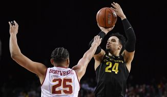 Oregon forward Dillon Brooks, right, shoots as Southern California forward Bennie Boatwright defends during the first half of an NCAA college basketball game, Saturday, Feb. 11, 2017, in Los Angeles. (AP Photo/Mark J. Terrill)