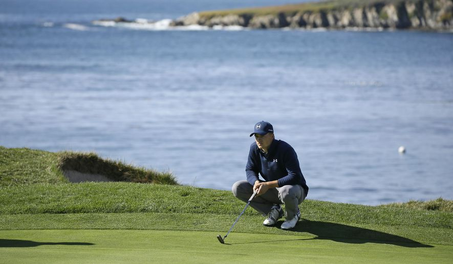 Jordan Spieth looks over the fourth green of the Pebble Beach Golf Links during the final round of the AT&T Pebble Beach National Pro-Am golf tournament Sunday, Feb. 12, 2017, in Pebble Beach, Calif. (AP Photo/Eric Risberg)