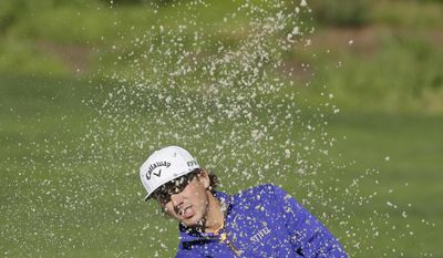 Kelly Kraft hits out of a bunker to the second green of the Pebble Beach Golf Links during the final round of the AT&T Pebble Beach National Pro-Am golf tournament Sunday, Feb. 12, 2017, in Pebble Beach, Calif. (AP Photo/Eric Risberg)