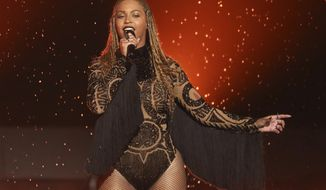 """FILE - In this June 26, 2016, file photo, Beyonce performs """"Freedom"""" at the BET Awards in Los Angeles. There are few things Beyonce has not conquered, and the Grammy for album of the year is one of them. Beyonce's main competition is Adele, who won album, song and record of the year in 2010 with """"21"""" and """"Rolling In the Deep."""" The 2017 Grammy Awards are held Sunday, Feb. 12, 2017. (Photo by Matt Sayles/Invision/AP, File)"""