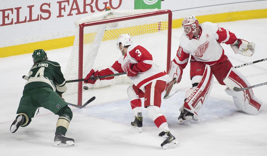 Minnesota Wild center Mikael Granlund, of Finland, (64) scores against Detroit Red Wings goalie Jared Coreau (31) as Detroit's Nick Jensen (3 defends during the first period of an NHL hockey game, Sunday, Feb. 12, 2017, in St. Paul, Minn. (AP Photo/Paul Battaglia)