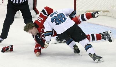 San Jose Sharks center Michael Haley (38) fights with New Jersey Devils defenseman Seth Helgeson (39) during the second period of an NHL hockey game, Sunday, Feb. 12, 2017, in Newark, N.J. (AP Photo/Mel Evans)