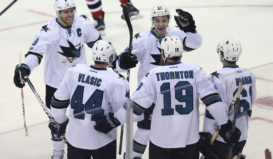 San Jose Sharks players celebrate a goal by forward Joe Thornton (19) during the second period of an NHL hockey game against the New Jersey Devils, Sunday, Feb. 12, 2017, in Newark, N.J. (AP Photo/Mel Evans)