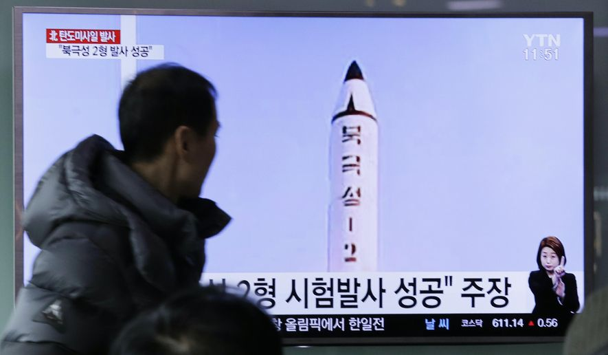 "A man watches a TV news program showing a photo published in North Korea's Rodong Sinmun newspaper of North Korea's ""Pukguksong-2"" missile launch,  at Seoul Railway station in Seoul, South Korea, Monday, Feb. 13, 2017. In an implicit challenge to President Donald Trump, North Korea fired a ballistic missile early Sunday in its first such test of the year. The sign read "" Pukguksong-2."" (AP Photo/Ahn Young-joon)"