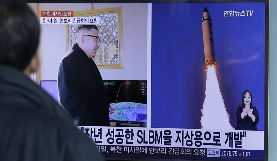 "A man watches a TV news program showing photos published in North Korea's Rodong Sinmun newspaper of North Korea's ""Pukguksong-2"" missile launch and North Korean leader Kim Jong-un at Seoul Railway Station in Seoul, South Korea, Monday, Feb. 13, 2017. In an implicit challenge to President Donald Trump, North Korea fired a ballistic missile early Sunday in its first such test of the year. The letters read ""Submarine-Launched Ballistic Missiles developed for ground use."" (AP Photo/Ahn Young-joon)"
