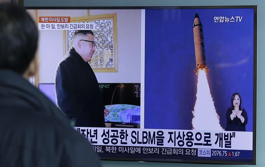 """A man watches a TV news program showing photos published in North Korea's Rodong Sinmun newspaper of North Korea's """"Pukguksong-2"""" missile launch and North Korean leader Kim Jong-un at Seoul Railway Station in Seoul, South Korea, Monday, Feb. 13, 2017. In an implicit challenge to President Donald Trump, North Korea fired a ballistic missile early Sunday in its first such test of the year. The letters read """"Submarine-Launched Ballistic Missiles developed for ground use."""" (AP Photo/Ahn Young-joon)"""
