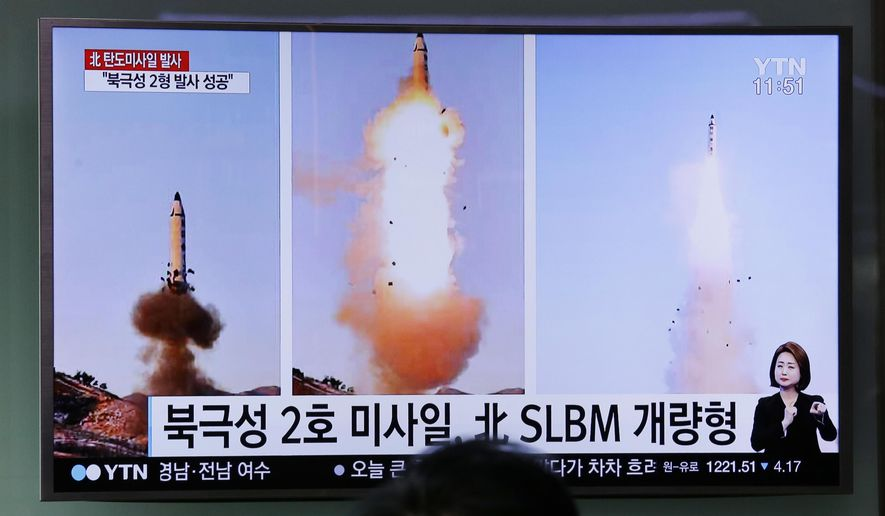 "A man watches a TV news program showing photos published in North Korea's Rodong Sinmun newspaper of North Korea's ""Pukguksong-2"" missile launch at Seoul Railway station in Seoul, South Korea, Monday, Feb. 13, 2017. In an implicit challenge to President Donald Trump, North Korea fired a ballistic missile early Sunday in its first such test of the year. The letters read ""Pukguksong-2 missile and advanced Submarine-Launched Ballistic Missiles."" (AP Photo/Ahn Young-joon)"