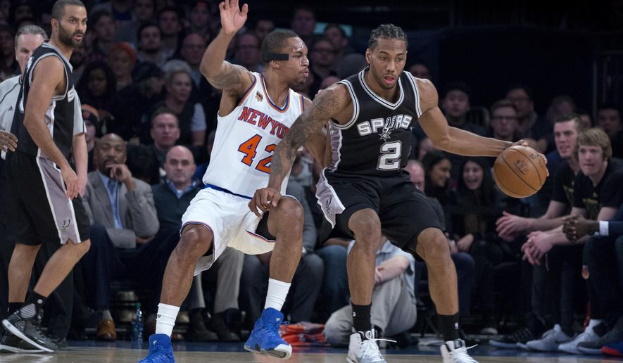 New York Knicks forward Lance Thomas (42) stays with San Antonio Spurs forward Kawhi Leonard (2) in the first half of an NBA basketball game at Madison Square Garden in New York, Sunday, Feb. 12, 2017. (AP Photo/Craig Ruttle)
