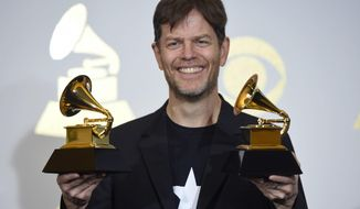 Donny McCaslin poses in the press room with the awards for at the 59th annual Grammy Awards at the Staples Center on Sunday, Feb. 12, 2017, in Los Angeles. (Photo by Chris Pizzello/Invision/AP)