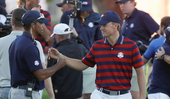 Jordan Spieth became the youngest player Sunday since Tiger Woods to win nine times on the PGA Tour, fueling even more comparisons to the golf legend. (Associated Press)