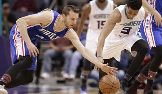 Charlotte Hornets' Jeremy Lamb (3) and Philadelphia 76ers' Nik Stauskas (11) chase a loose ball in the first half of an NBA basketball game in Charlotte, N.C., Monday, Feb. 13, 2017. (AP Photo/Chuck Burton)