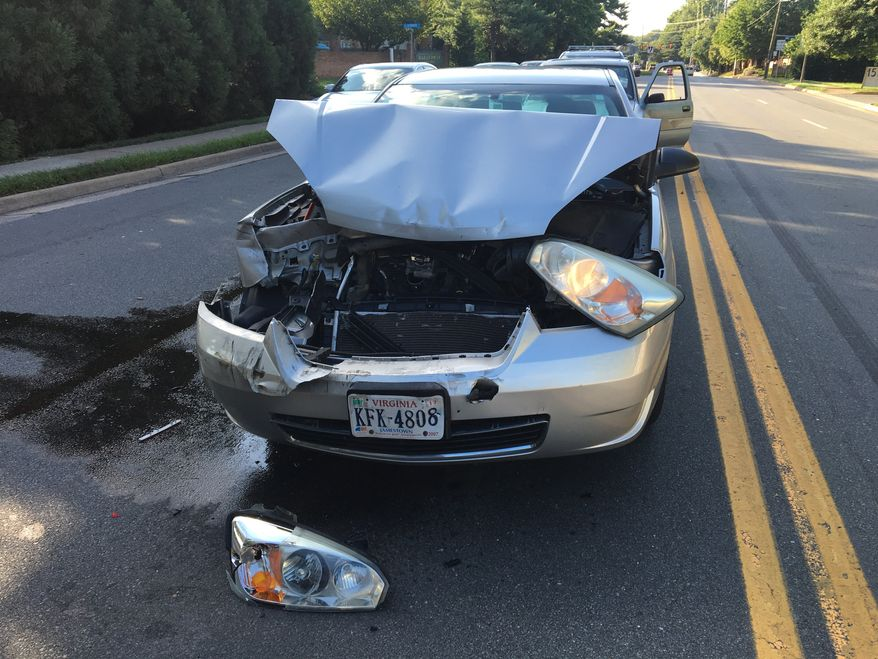In this photo taken Feb. 9, 2016, a car involved in an accident sits in the road Virginia. The Consumer Federation of America says it found premium hikes in some cases reaching $400. It looked at premium quotes in 10 cities from five of the nations largest auto insurers and found that Progressive aggressively used a not-at-fault penalty, surcharging drivers in eight of the ten cities.  (AP Photo/Jennifer C. Kerr)