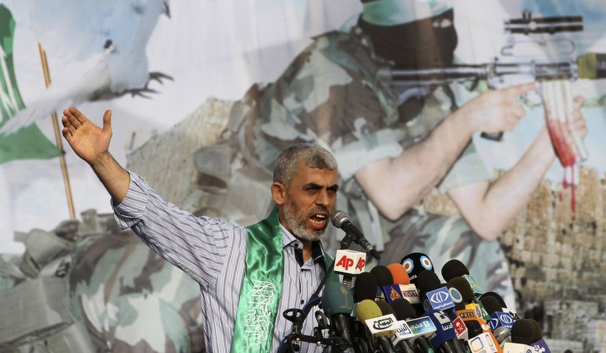 Freed Palestinian prisoner Yehiya Sinwar, a founder of Hamas' military wing, talks during a rally in Khan Younis, southern Gaza Strip, in this Friday, Oct. 21, 2011, file photo. (AP Photo/Adel Hana)