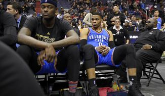 Oklahoma City Thunder guard Russell Westbrook (0) looks on from the bench during the final minute of an NBA basketball game against the Washington Wizards, Monday, Feb. 13, 2017, in Washington. The Wizards won 120-98. (AP Photo/Nick Wass)