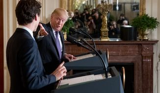 President Donald Trump speaks while on stage with Canadian Prime Minister Justin Trudeau, left, during a joint news conference in the East Room of the White House in Washington, Monday, Feb. 13, 2017. (AP Photo/Andrew Harnik)