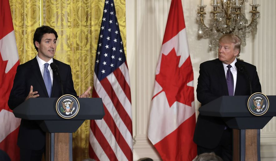 President Donald Trump and Canadian Prime Minister Justin Trudeau participate in a joint news conference in the East Room of the White House in Washington, Monday, Feb. 13, 2017.  (AP Photo/Evan Vucci)