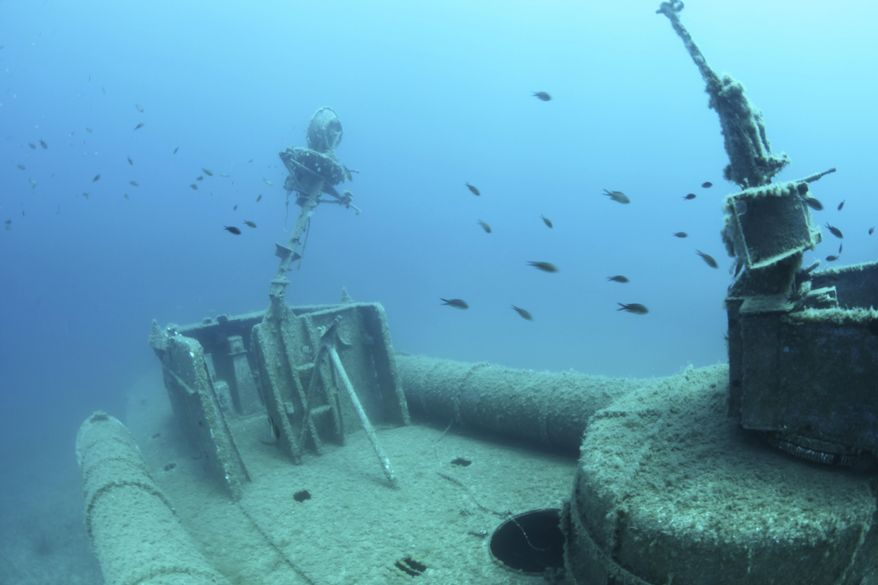 This undated picture provided on Monday, Feb. 13, 2017, by the Albanian National Coastline Agency shows a shipwreck discovered by the RPM's Hercules research vessel in Ionian Sea, Albania. The country is promoting the archaeological finds in the waters off its southwest coast to raise public interest and to attract attention of decision-makers who can help preserve the discoveries. The Albanian National Coastline Agency opened an exhibition on Monday, Feb. 13 of 30 pictures showing underwater finds of potential archaeological significance from the last decade. (The Albanian National Coastline Agency via AP)
