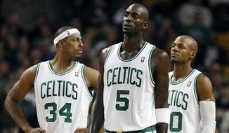 Boston Celtics' Paul Pierce (34), Kevin Garnett (5) and Ray Allen (20) wait for play to resume after a timeout in the fourth quarter of an NBA basketball game against the Indiana Pacers in Boston, in this Jan. 5, 2012, file photo. (AP Photo/Michael Dwyer, File)