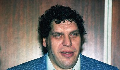 """FILE - This is a 1988 file photo showing professional wrestler Andre the Giant. HBO Sports, and the Bill Simmons Media Group will produce """"Andre The Giant,"""" a documentary film examining the life and career of one of wrestling's biggest stars. The film will explore Andre's upbringing in France, his celebrated career in WWE and his forays in the entertainment world. (AP Photo/Richard Drew, File)"""