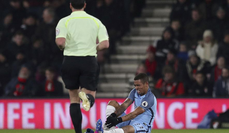 Manchester City's Gabriel Jesus sits on the pitch during their English Premier League soccer match against Bournemouth, at the Vitality Stadium in Bournemouth, England, Monday Feb. 13, 2017. (Andrew Matthews/PA via AP)