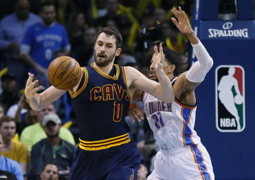 Cleveland Cavaliers forward Kevin Love bobbles the ball in front of Oklahoma City Thunder forward Andre Roberson (21) during the third quarter of an NBA basketball game in Oklahoma City, Thursday, Feb. 9, 2017. Oklahoma City won 118-109. (AP Photo/Sue Ogrocki)