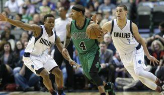 Boston Celtics guard Isaiah Thomas (4) dribbles against Dallas Mavericks defenders Yogi Ferrell (11) and Dwight Powell during the first half of an NBA basketball game in Dallas, Monday, Feb. 13, 2017. (AP Photo/LM Otero)