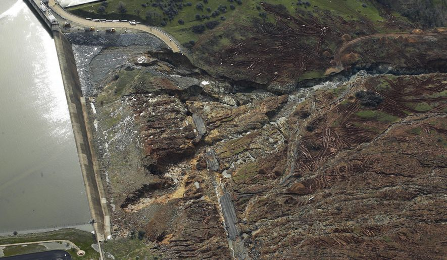 This photo shows erosion caused when overflow water cascaded down the emergency spillway of the Oroville Dam, Monday, Feb. 13, 2017, in Oroville, Calif. The water level dropped Monday at the nation's tallest dam, easing slightly the fears of a catastrophic spillway collapse that prompted authorities to order people to leave their homes downstream. (AP Photo/Rich Pedroncelli)
