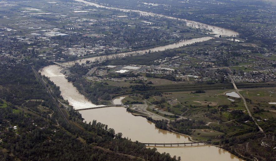 The water from the Feather River flows through Oroville, Calif., Monday, Feb. 13, 2017. Water levels at Lake Oroville, which feeds the river are continuing to drop, stopping water from spilling over the spillway. Thousands of Northern California residents were asked to evacuate their homes Sunday evening after authorities warned the emergency spillway of the Oroville Dam could fail at any time unleashing uncontrolled flood waters on towns below. (AP Photo/Rich Pedroncelli)